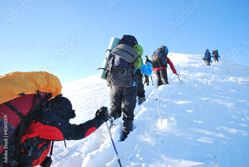 Hike in winter mountain