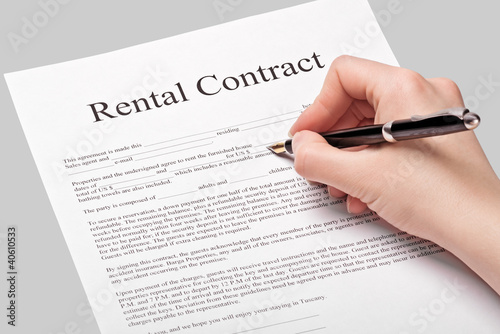 Rental contract form with pen