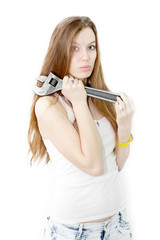 beautiful girl keeps in the hands wrench