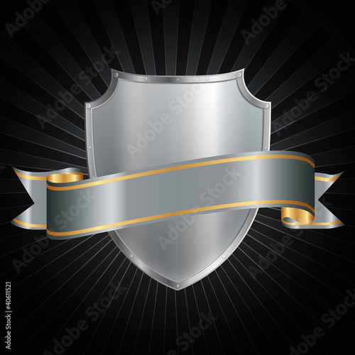 Silver shield with a shiny silver ribbon on a grunge background.