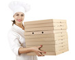 cook woman in white uniform with boxes of pizza