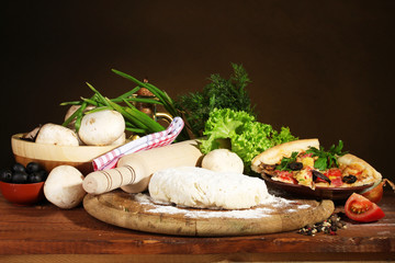 delicious pizza dough, spices and vegetables