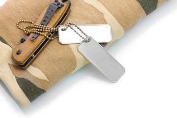 Army badges, knife and camouflage isolated on white