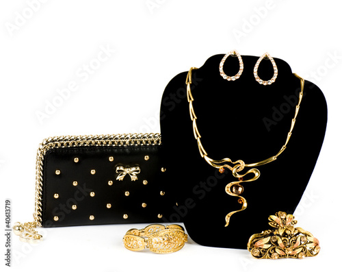 Fashionable handbag and golden jewelry