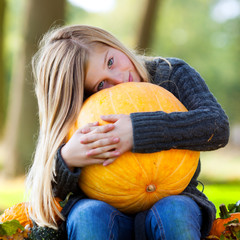 girl with huge pumpkin