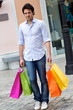 Attractive young man with shopping bags,