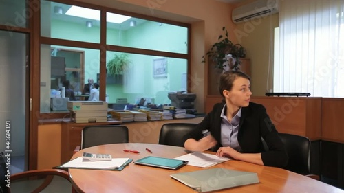 Attractive young woman and man working in office