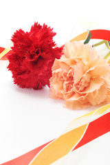 Red and orange carnations with colorful ribbon