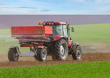 Fototapety an agricultural tractor starts a chemical treatment