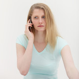 Worried woman on her mobile phone