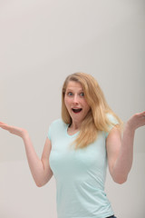 Woman shrugging her shoulders and raising her hands