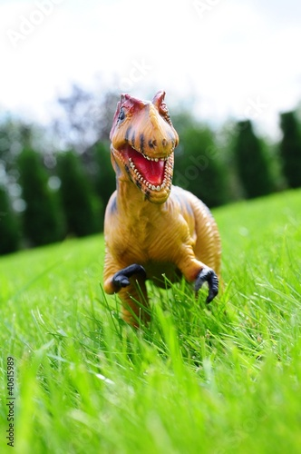 dinosaur toy on grass