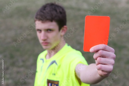 young boy and red card