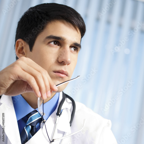 Portrait of young doctor at office