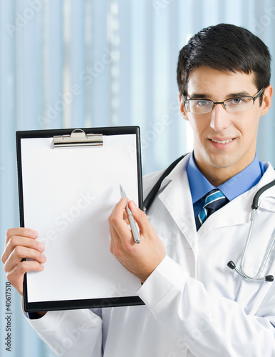 Doctor with clipboard at office