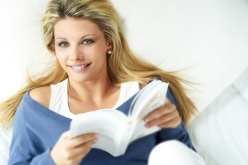 young blond girl reading