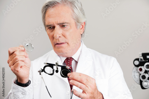Optometrist Checking the Lens Of Trial Frame