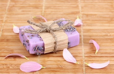Hand-made lavender soap on wooden mat