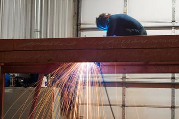 Welder working the job in the shop