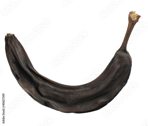 Dry brown banana isolated on white background