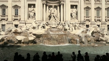 People and tourists visiting Trevi Fountain, Rome, Italy