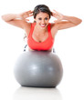 Woman exercising with pilates ball