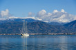 Sailing megayacht on awesome mountains background