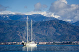 Sailing megayacht on awesome mountains background poster