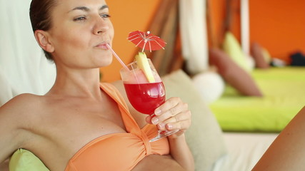 Young sexy woman drinking exotic cocktail in luxury bar