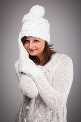 Young attractive woman dressed in winter clothes