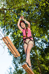Girl climbing in adventure park