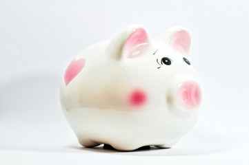 a piggy saving box on white background