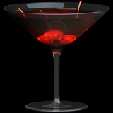 Martini glass with cherry isolated on a black background.