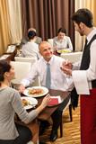 Business lunch waiter taking order at restaurant poster