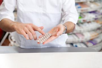 Male Pharmacist Giving Prescription Medicine