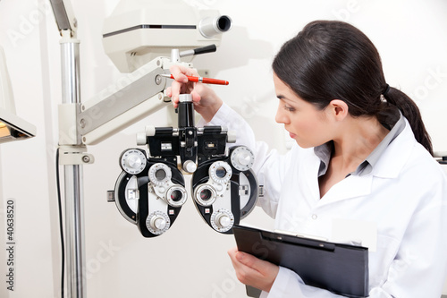 Optometrist Looking at Phoropter