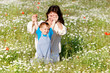 mother and child playing in flower field