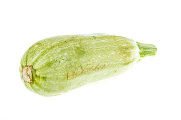Single Courgette or zucchini from low perspective isolated on wh