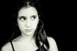 Sad hispanic girl with tears on her face
