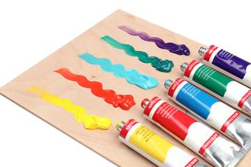 Five paint tubes over a pallete