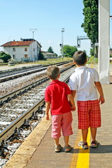 two brothers,children waiting for the train station