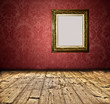 Blank golden frame on grunge wall
