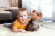 little boy playing and hugging loving dog york