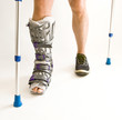 Man with a broken leg with Orthotic