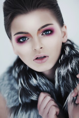 Attractive glamorous sexy woman brunette in fur collar