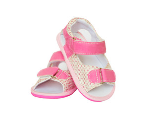 Pink pair of baby girl little shoes with laces isolated