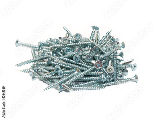Random pile of round threaded steel screw