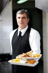 male chef presenting food