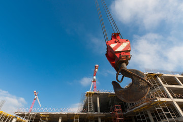 hook of crane on background building under construction