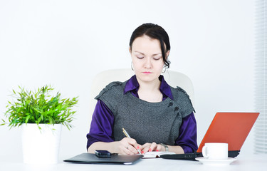 Serious business woman writing